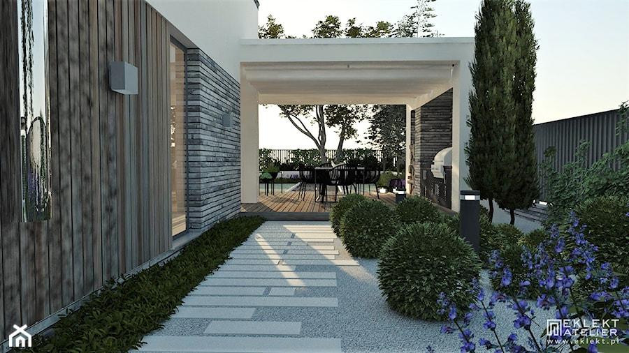 BRYŁA DOMU Z OGRODEM W BOLECHOWICACH - Średni ogród za domem, styl nowoczesny - zdjęcie od EKLEKT ATELIER