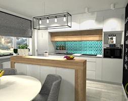 Mieszkanie pod Bydgoszczą - Średnia otwarta szara kuchnia dwurzędowa z wyspą z oknem, styl skandynawski - zdjęcie od DW Wnętrza