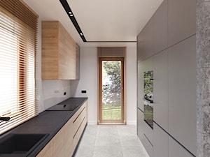 DOM W FIRLEJU - Duża zamknięta wąska szara kuchnia dwurzędowa z oknem, styl nowoczesny - zdjęcie od BDWstudio