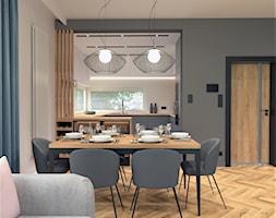 Jadalnia+w+salonie+z+kuchni%C4%85+-+zdj%C4%99cie+od+BDWstudio