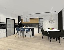 Styl nowoczesny na nowym osiedlu w Radomiu - Duża otwarta czarna szara jadalnia w kuchni, styl nowoczesny - zdjęcie od Architextura