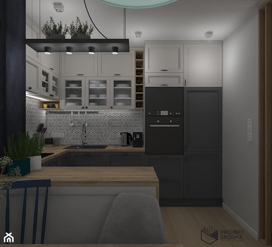 Widok na zabudowę kuchni - zdjęcie od Projekt Środka