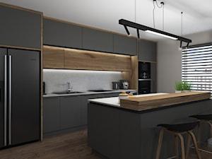 Widok na kuchnię i wyspę - zdjęcie od Projekt Środka