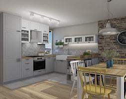 Widok na kuchnię otwartą - zdjęcie od Projekt Środka