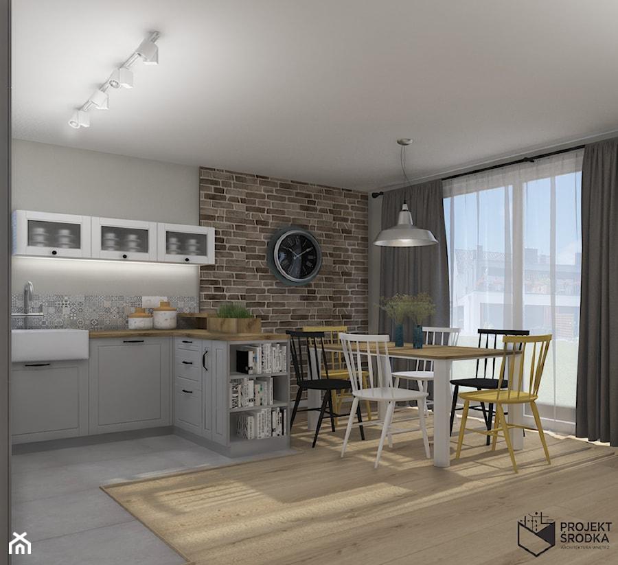 Widok na jadalnię i kuchnię - zdjęcie od Projekt Środka