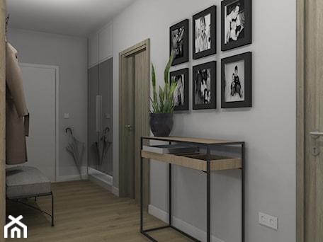 Aranżacje wnętrz - Hol / Przedpokój: Widok na wejście do mieszkania - Projekt Środka. Przeglądaj, dodawaj i zapisuj najlepsze zdjęcia, pomysły i inspiracje designerskie. W bazie mamy już prawie milion fotografii!