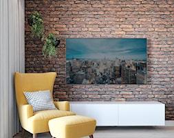 Salon z żółtym fotel i cegłą - zdjęcie od Auroom Concept - Homebook