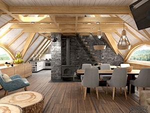 salon z jadalnią na poddaszu drewnianego domku weekendowego - zdjęcie od balhouse - projektowanie wnętrz