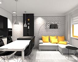 MIESZKANIE Z ŻÓŁTYM AKCENTEM - Mały biały salon z kuchnią z jadalnią, styl nowoczesny - zdjęcie od KRET'''KA PRACOWNIA PROJEKTOWA