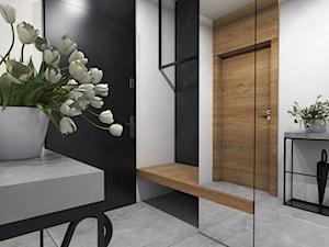 Dom Suchy Dwór - Mały biały czarny hol / przedpokój, styl nowoczesny - zdjęcie od Studio 23A