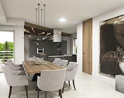 Apartament Iława - Duża otwarta biała czarna jadalnia w kuchni w salonie, styl nowoczesny - zdjęcie od Studio 23A