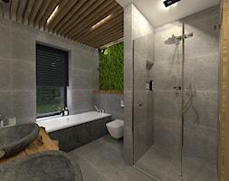 Łazienka w naturalnym kamieniu z dekoracyjnm mchem na ścianie - zdjęcie od sandroom
