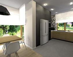 Kuchnia z geometrycznymi płytkami nad blatem - zdjęcie od sandroom