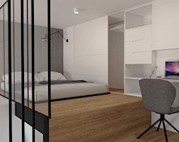 Sypialnia na antresoli z miejscem na biurko chowane w zabudowie - zdjęcie od sandroom
