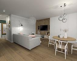 Jasny+salon+z+kuchni%C4%85+w+stylu+skandynawskim+-+zdj%C4%99cie+od+sandroom