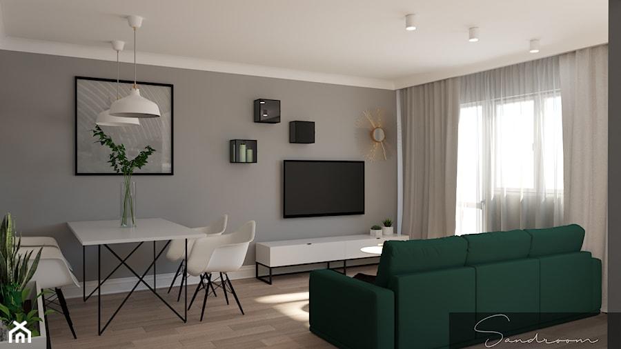 Salon z kanapą w kolorze butelkowej zieleni - zdjęcie od sandroom