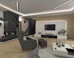 Nowoczesny i ponadczasowy salon z podświetlaną ścianą TV - zdjęcie od sandroom