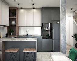 Nowoczesne mieszkanie ze złotymi dodatkami - Średnia biała kuchnia w kształcie litery u w aneksie z wyspą, styl nowoczesny - zdjęcie od DEZEEN ARCHITEKCI Natalia Pęcka