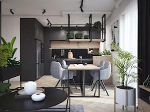 Mieszkanie w ciemnych barwach z dodatkiem zieleni