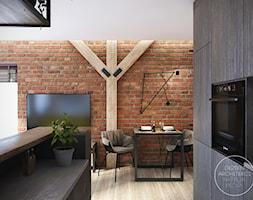 Mieszkanie w stylu industrialnym - Mała otwarta brązowa jadalnia w kuchni w salonie, styl industrialny - zdjęcie od DEZEEN ARCHITEKCI Natalia Pęcka