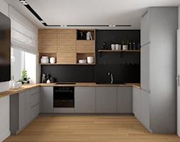 Mieszkanie w Krakowie - Średnia biała czarna kuchnia w kształcie litery u w aneksie z oknem, styl nowoczesny - zdjęcie od VINSO projektowanie wnętrz