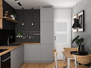 Mieszkanie w Krakowie - Średnia zamknięta szara czarna kuchnia w kształcie litery l, styl nowoczesny - zdjęcie od VINSO projektowanie wnętrz