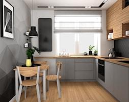 Mieszkanie w Krakowie - Mała zamknięta szara czarna kuchnia w kształcie litery l z oknem, styl nowoczesny - zdjęcie od VINSO projektowanie wnętrz
