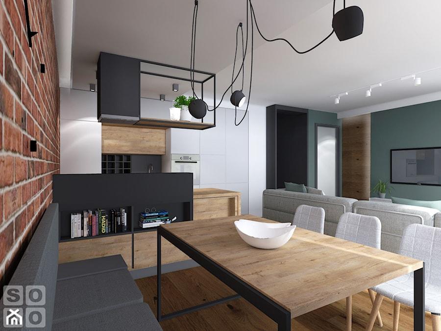 Dom w Ścinawie - Średnia otwarta biała jadalnia w kuchni w salonie, styl industrialny - zdjęcie od Studio Soko