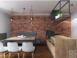Dom w Ścinawie - Duża brązowa szara jadalnia w kuchni, styl industrialny - zdjęcie od Studio Soko