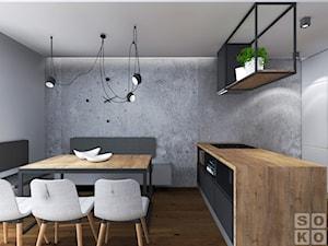 Dom w Ścinawie - Średnia otwarta szara jadalnia w kuchni, styl industrialny - zdjęcie od Studio Soko