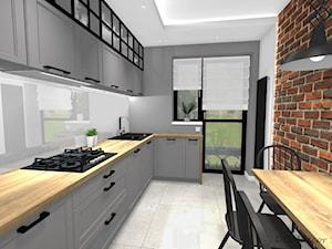 Projekt korytarza, salonu oraz kuchni w stylu industrialnym - Średnia zamknięta szara kuchnia w kształcie litery l z oknem, styl industrialny - zdjęcie od DOMdecor Studio Klaudiusz Klepacki