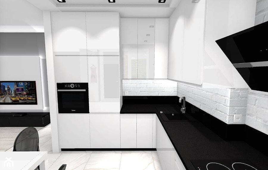 Aranżacje wnętrz - Kuchnia: Małe mieszkanie w stylu nowoczesnym - Średnia otwarta biała kuchnia w kształcie litery l w aneksie, styl nowoczesny - DOMdecor Studio Klaudiusz Klepacki. Przeglądaj, dodawaj i zapisuj najlepsze zdjęcia, pomysły i inspiracje designerskie. W bazie mamy już prawie milion fotografii!