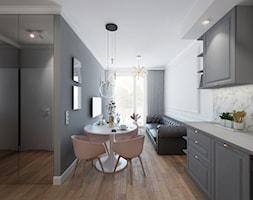 MIESZKANIE 04. Warszawa - Mała otwarta biała szara jadalnia w kuchni w salonie - zdjęcie od Projekt M pracownia architektoniczna