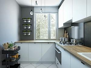 MIESZKANIE 02. Pabianice - Średnia zamknięta szara czarna kuchnia w kształcie litery l z oknem - zdjęcie od Projekt M pracownia architektoniczna