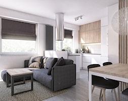 MIESZKANIE 05.Łask - Mały biały salon z kuchnią z jadalnią z tarasem / balkonem - zdjęcie od Projekt M pracownia architektoniczna