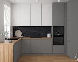Mieszkanie w Lublinie - Średnia otwarta biała czarna kuchnia w kształcie litery l z oknem, styl nowoczesny - zdjęcie od COMFY LIFE