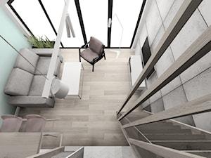 Mieszkanie na wynajem z antresolą - Żory - Mały szary turkusowy salon z jadalnią z antresolą, styl industrialny - zdjęcie od KOCHAN wnętrza