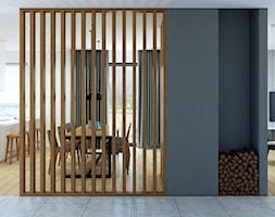 Ścianka ażurowa i wnęka na drewno - zdjęcie od MACZ Architektura