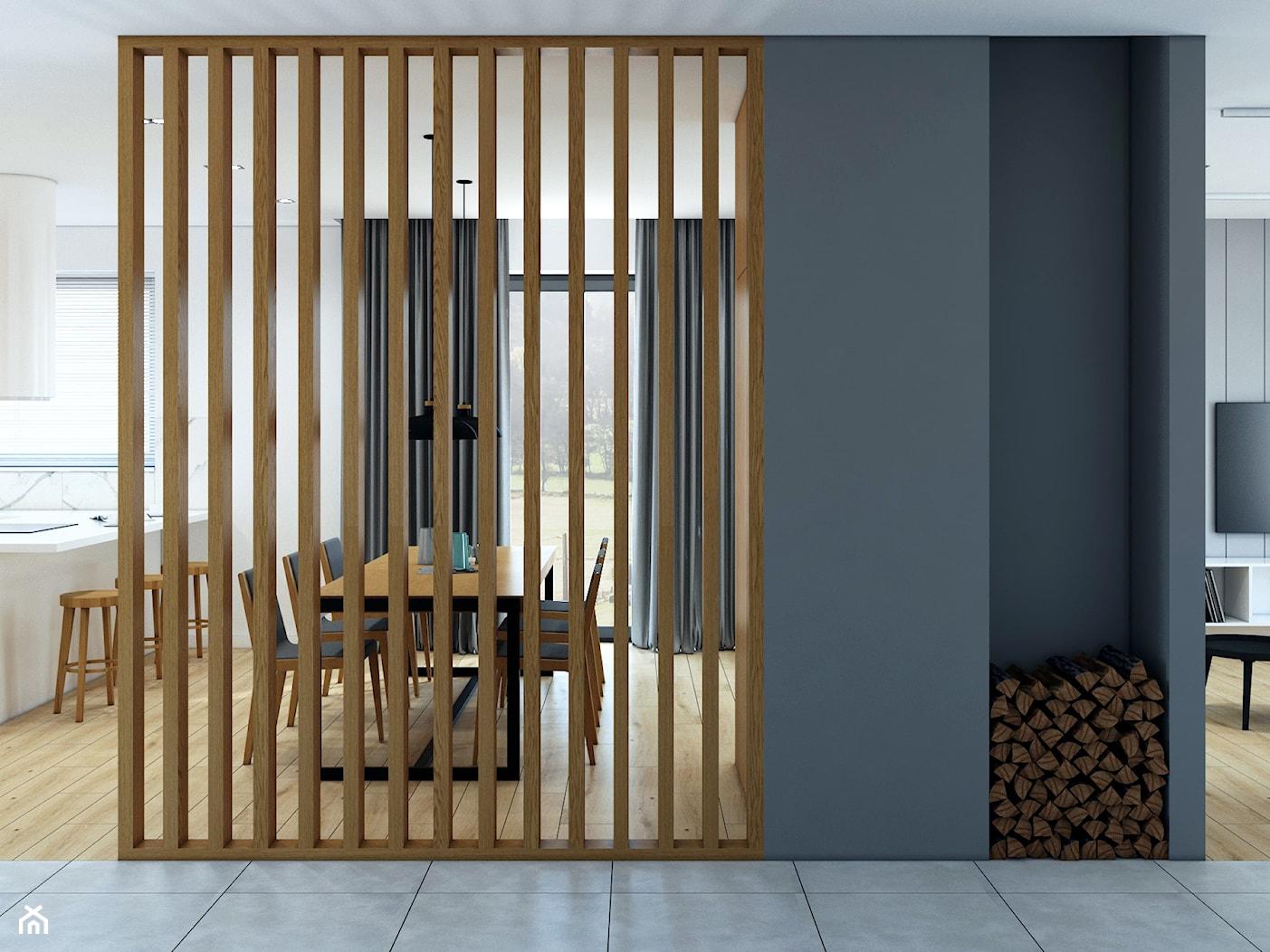 Ścianka ażurowa i wnęka na drewno - zdjęcie od MACZ Architektura - Homebook