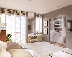 Dom w Holandii - Duża beżowa sypialnia małżeńska z garderobą, styl skandynawski - zdjęcie od Finchstudio Architektura Wnętrz