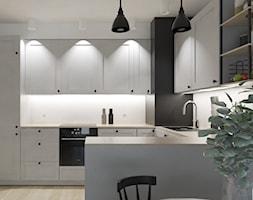 Mieszkanie Jasień Bulwary Gdańsk - Średnia otwarta biała czarna kuchnia w kształcie litery u w aneksie - zdjęcie od MP-DESIGN