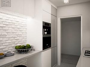 Biele i szarości w kuchni