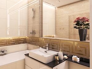 złota łazienka, trawertyn - zdjęcie od OroConcept Anna Orowiecka-Stanisławska