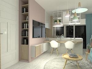 salon z kuchnią i jadalnią w pastelach - zdjęcie od decostory