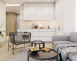 The beginning - Mały biały salon z kuchnią, styl nowoczesny - zdjęcie od EDYCJA studio - Homebook