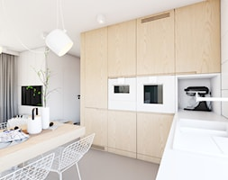 Scandi - Średnia otwarta biała kuchnia w kształcie litery l w aneksie z oknem, styl skandynawski - zdjęcie od EDYCJA studio