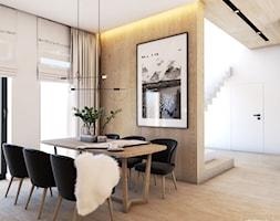 Origami - Duża otwarta biała beżowa jadalnia w salonie - zdjęcie od EDYCJA studio