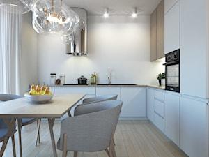 Mieszkanie I - Średnia otwarta biała kuchnia w kształcie litery l z oknem, styl nowoczesny - zdjęcie od MINIMAL.
