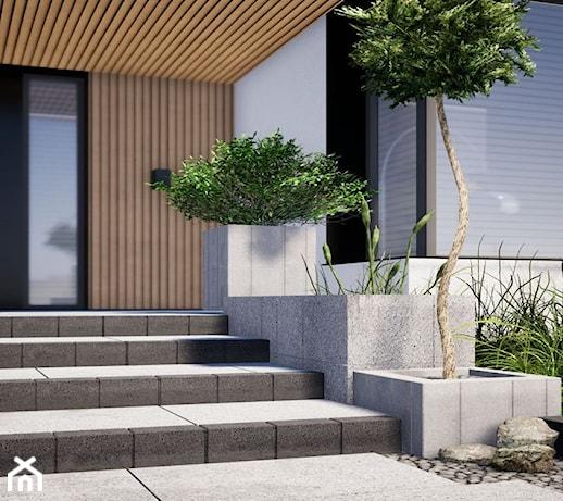 Mała architektura w ogrodzie – jak wykorzystać murki, obrzeża, palisady i donice?