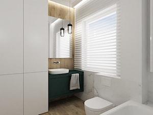 Marmurowa łazienka z zieloną szafką - zdjęcie od Reforma Domu